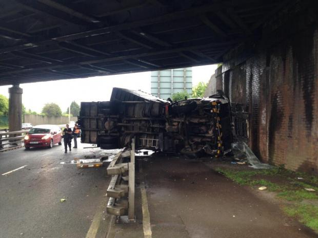 South Wales Argus: CRASH: The lorry on its side on the westbound side of the SDR (Picture courtesy of Carl Slocombe)