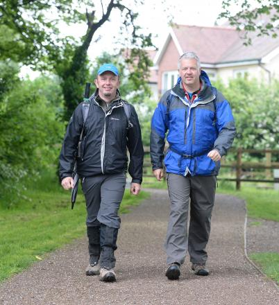 STEPPING OUT: Derek Brockway filming Weatherman Walking in Newport seen here near 14 Locks Canal Centre with Newport artist Joseph Connor