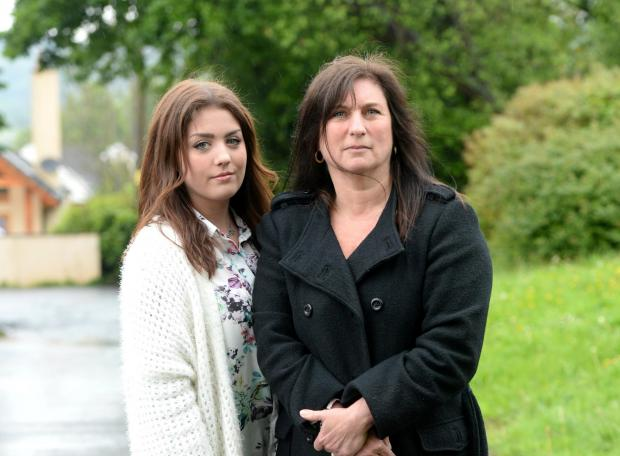 Jayne Jones and her daughter Keeley angry about bus price hike for Keeley to get to Sixth Form. Pictured are Jayne Jones and her daughter Keeley at home in Llandevaud (6507628)