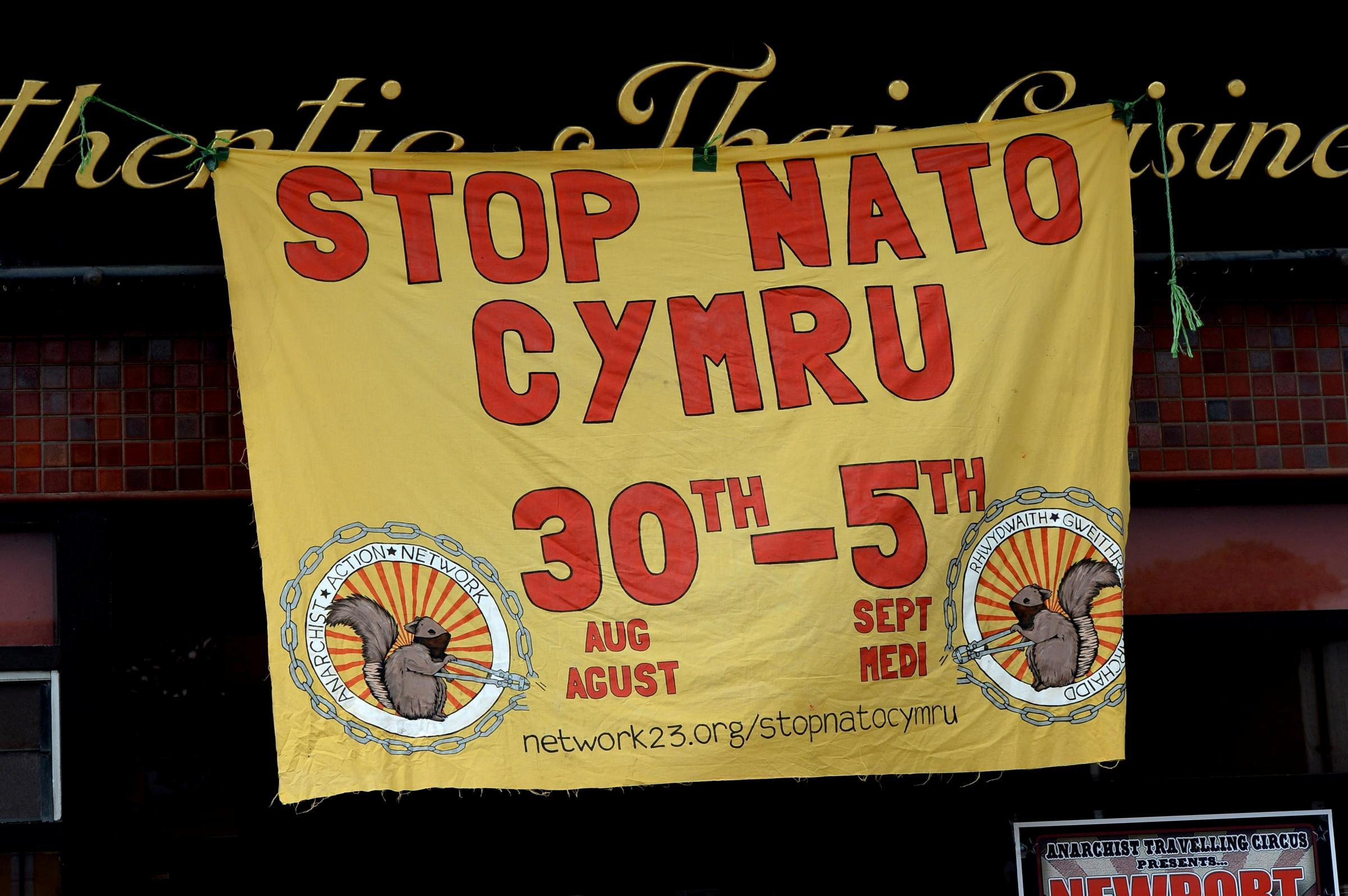 GV of front of window in Newport Commercial Street, where Anarchist Action Network are holding a week of events, ahead of NATO summit (6563268)