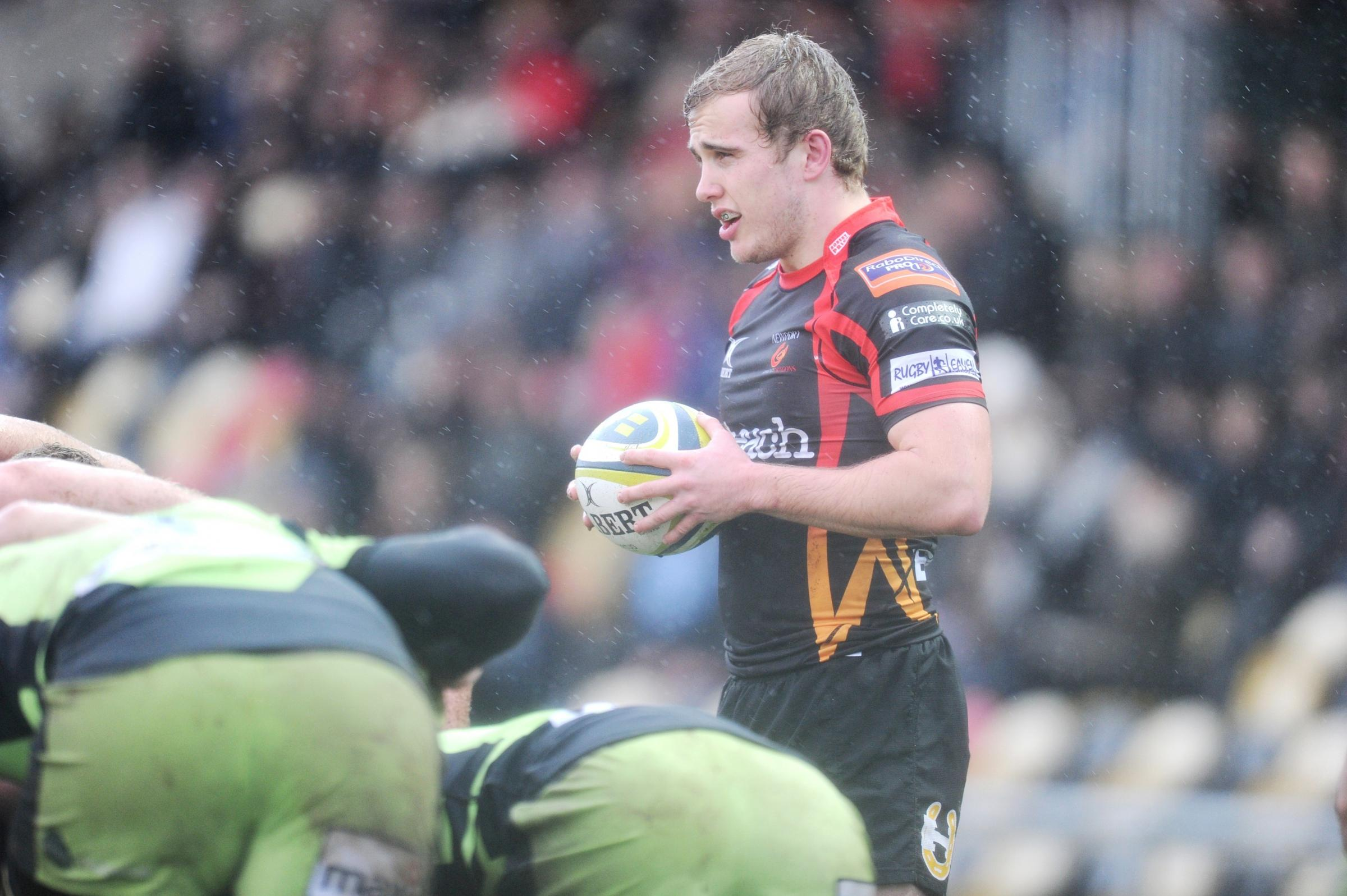 Newport Gwent Dragons v Northampton Saints in LV Cup.  Heavy downpours and hail stones interrupted the first half of the game as Scrum Half Luc Jones prepa