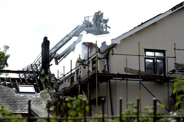BLAZE DRAMA: Firefighters were still at the scene this morning, more t
