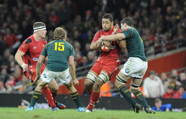 South Wales Argus: Toby Faletau is tackled by Francois Louw (2397256)