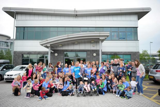 South Wales Argus: Celtic Springs Day Nursery held a sponsored toddle around the nearby lake for charity.  Pictured are staff, parents and children outside the nursery before the toddle.  (6907859)