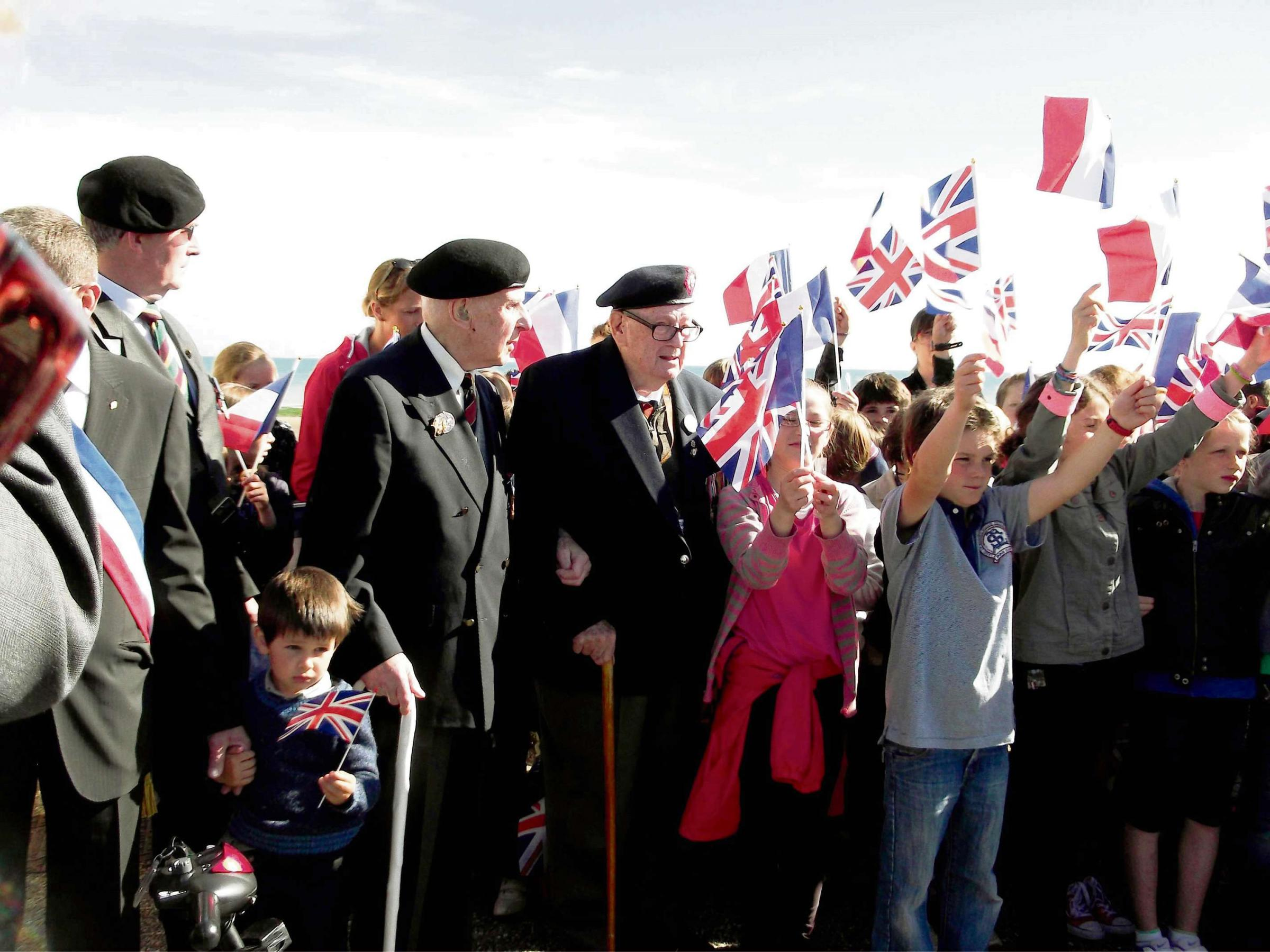 Veteran given hero's welcome on return to Normandy