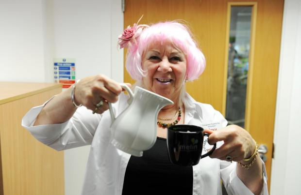 South Wales Argus: A Cwmbran Congress Theatre fundraiser Joyce Liddle took part in a sponsored tea lady service at Melin Homes.  Pictured is Joyce at the beginning of her tea round. (7020442)