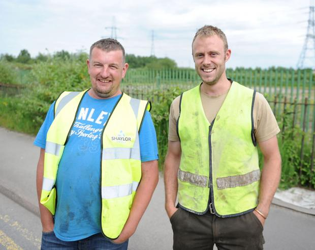 DISCOVERY: Andrew Tolley and Tom Jenkins, builders from CC Morgan and Sons who found the suspected bomb during ground works outside Pets At Home store in Newport