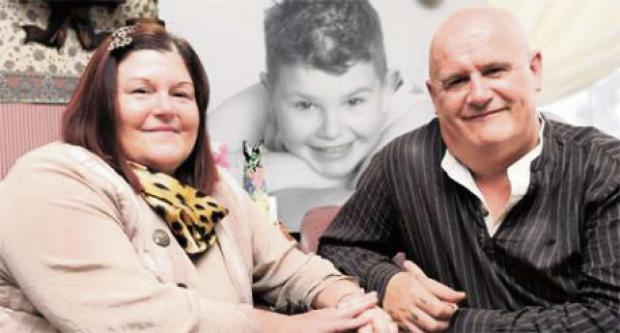 South Wales Argus: Wayne and Rosemary Yendle with a picture of their son Ieuan