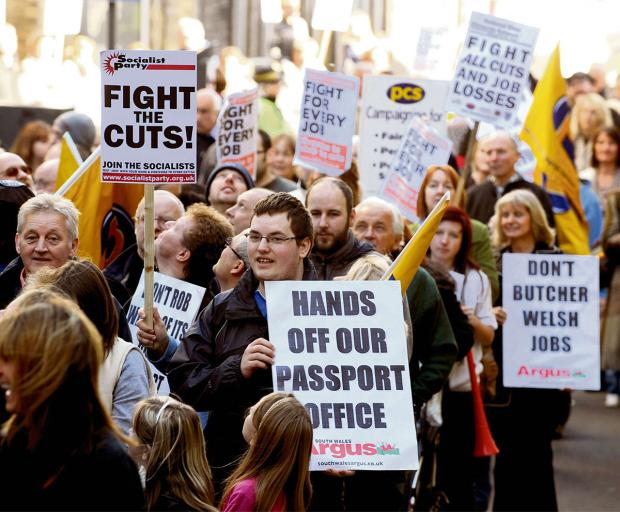 South Wales Argus: Protesters march through Newport during a demonstration against cuts to Newport passport jobs