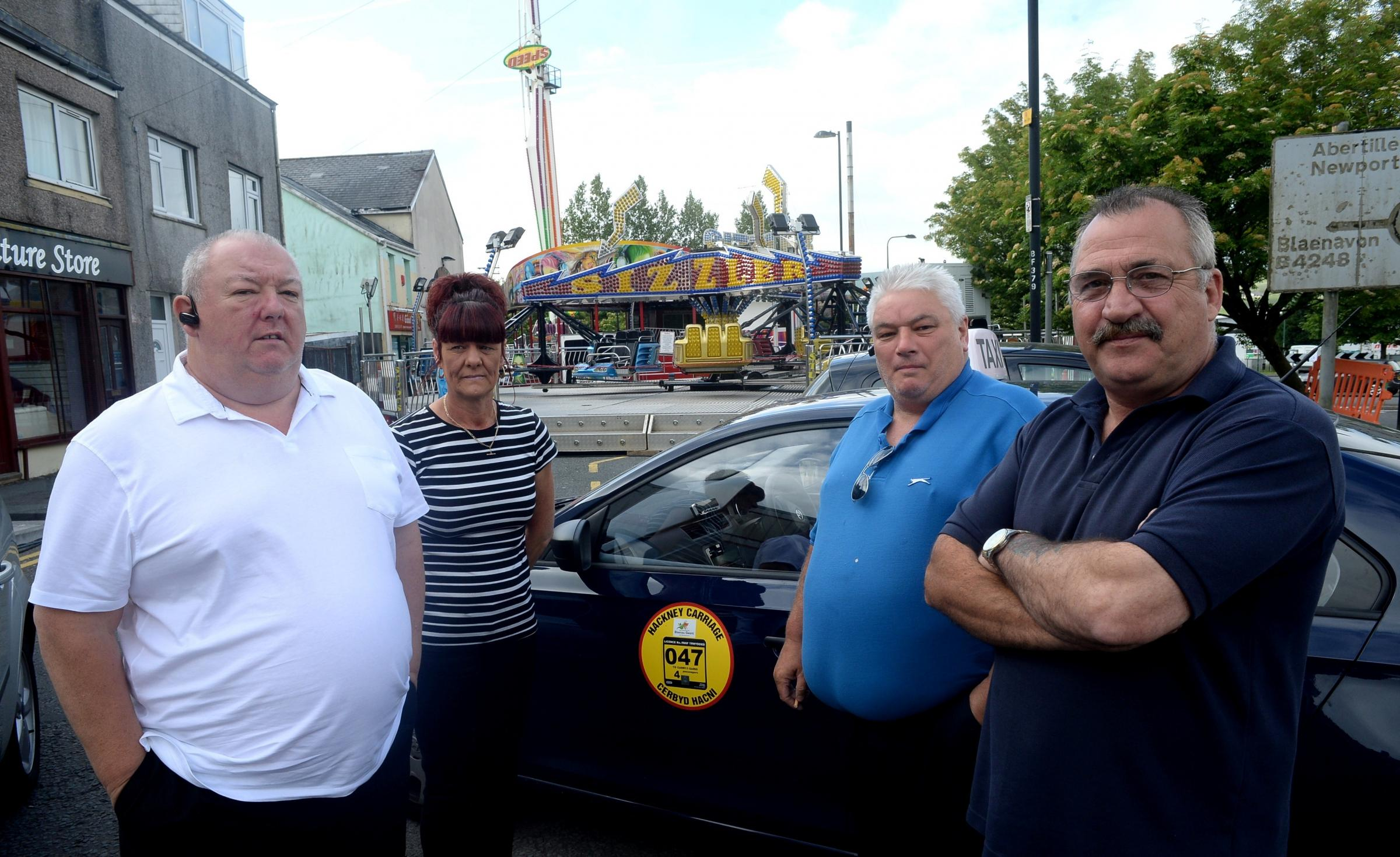BUSINESS DOWN Taxi drivers are angry that Brynmawr fair is affecting trade and causing chaos.Pictured from left, are Alan Morrell, Alison Gwillym, Tim Roberts and Mike Powell (7267504)