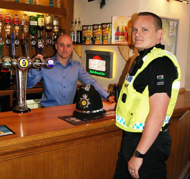 South Wales Argus: SAFER CAERPHILLY: PC Adam Lang with landlord of Porters Blackwood, Daniel Rees