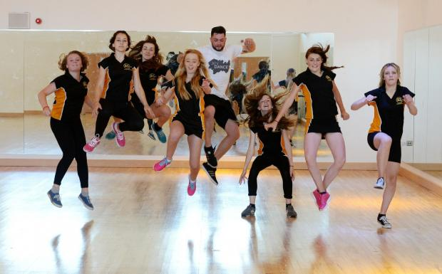 South Wales Argus: Koi Dance Company visit Risca Comprehensive School JUMP TO IT Pupils follow as dancer Billy Kennedy-Brown goes through a routine (7310700)