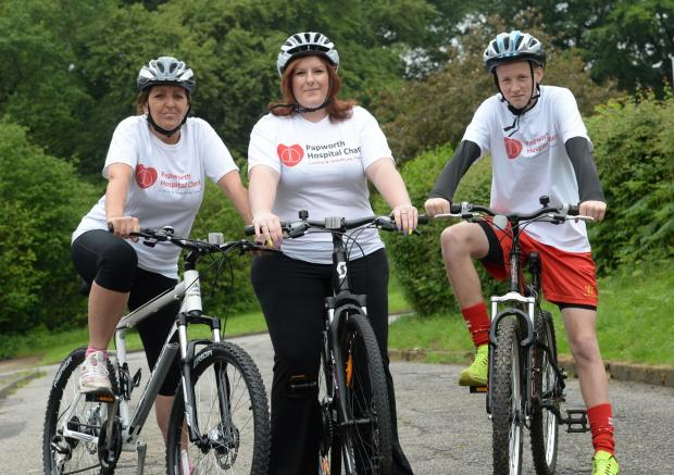 Angharad Cutler organising bike ride for charity. Pictured are (left to right) Helen Mort, Angharad Cutler, and Rhys Cutler on their bikes at home in Cwmbran. (6683693)