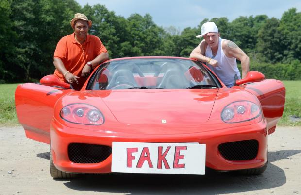 South Wales Argus: Carlton Lawrence has bought a replica Ferrari based on Japanese car. People take pix of it wherever he goes and have made comments about it so he has decided to write a rap music video about it with his friends. Pictured are Carlton Lawrence and Steve Sha