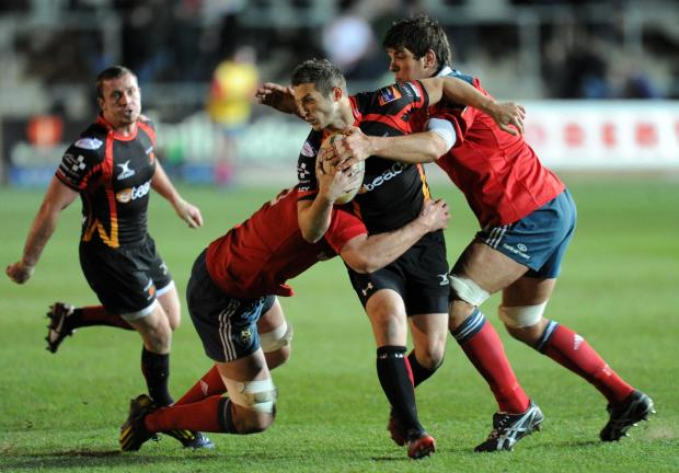 Jason Tovey is tackled by Billy Holland and Donncha O'Callaghan (2777286)