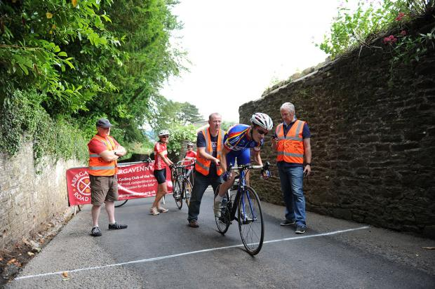AND THEY'RE OFF: The Deri Dash Hill Climb, at the start of Abergavenny's Festival of Cycling was held in aid of St  David's Hospice Care. Organiser David James, the father of Olympic cyclist Becky is pictured with Alex Touche of Ponthir