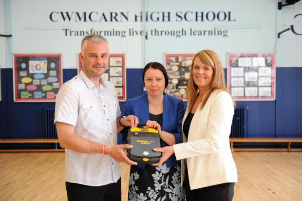 Jack's Appeal with General Dynamics UK presented a heart defibrillator to Cwmcarn High School.  Pictured from left Grant Thomas, Jacqui Peplinski Head Teacher and June Thomas. (7614421)
