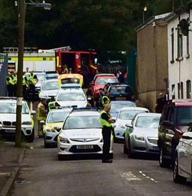 South Wales Argus: STANDOFF: Emergency services at Glandwr Street in Aberbeeg