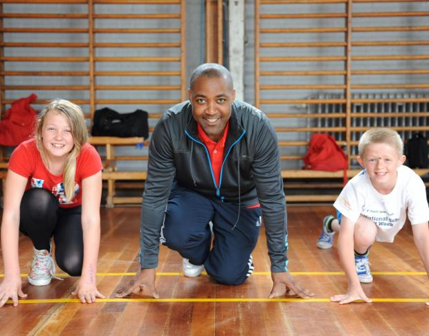 At Llantarnam High School, Olympic gold medallist Darren Campbell visited pupils to mark National School Sport Week. Pictured On Your Marks, is Emily Hollins 11, Darren and Ellis Roberts 10 both from Nant Celyn Primary School. (7618499)