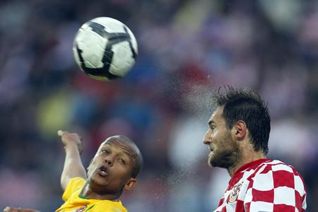 NO DEAL: Robert Earnshaw, left, in action for Wales against Croatia's Josip Simunic in 2010