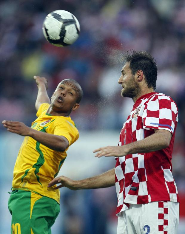 South Wales Argus: NO DEAL: Robert Earnshaw, left, in action for Wales against Croatia's Josip Simunic in 2010