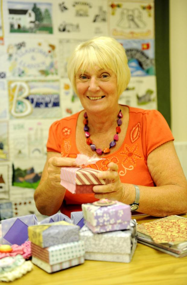 South Wales Argus: Pictured is Cwmbran WI member Annette O'Connell making some Origami boxes to feature in a demonstration at next years Royal Welsh show. (7738657)