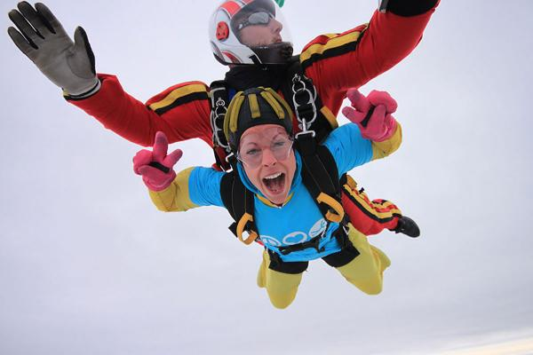 Daredevil lecturers raise over £700 in Ty Hafan skydive