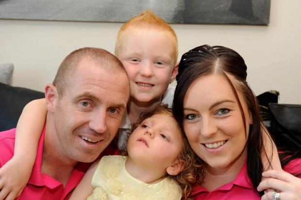 FUNDRAISING: Aiyla Fear with parents Lindsay and Karl Fear and brother Logan, four.