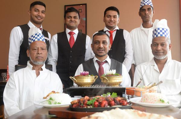 BEST IN WALES: Owner Shah Shafee, chefs Abdul Wadud, Liton Miah, Hanif Uddin, and waiters Ashraful, Shofiqul, and Azizul Islam of the New Lahore restaurant in Newport, which has been named best curry house in Wales.