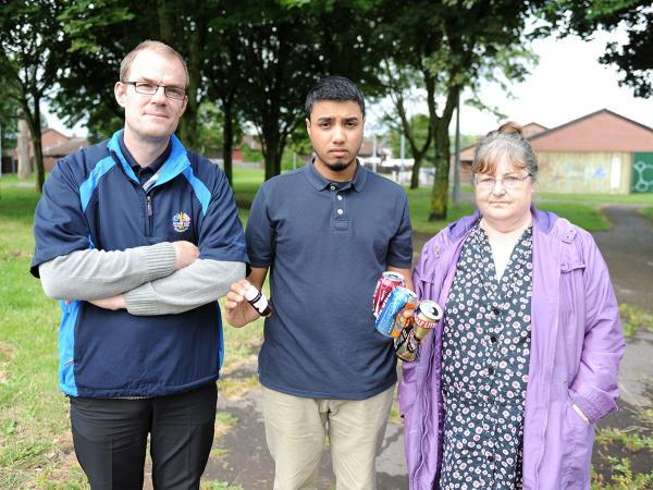 South Wales Argus: UPSET: Kamal Ali, centre, with Paul Murphy and Wendy Wall at Pill Park with bottles and cans they have found in the park