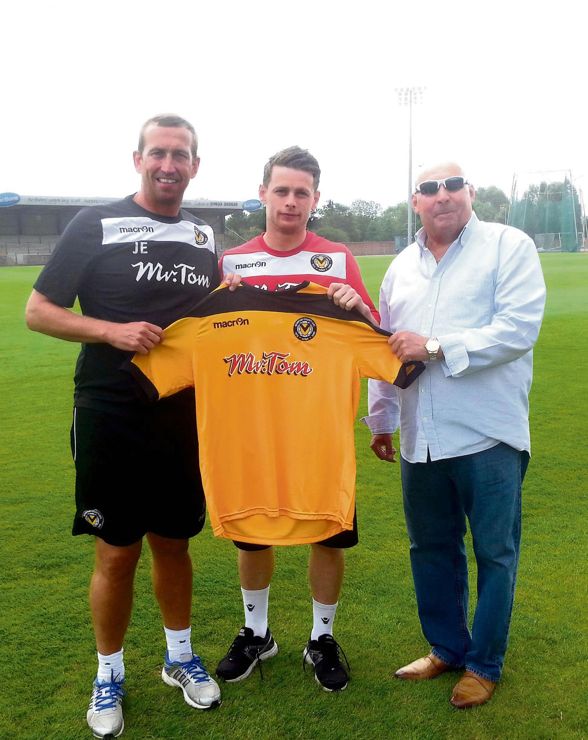 WELCOME: Mark Byrne, centre, with manager Justin Edinburgh, left, and chairman Les Scadding