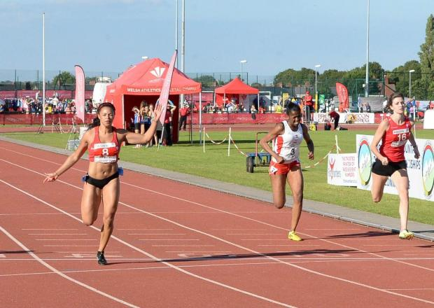VICTIRY: Mica Moore, left, wins the women's 100m A final at the Welsh Athletics International in Cardiff Picture: MIKE LEWIS