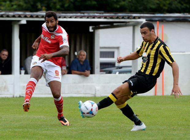 FINE FORM: Rene Howe, left, in action against Gloucester City on Saturday  Picture: MIKE LEWIS