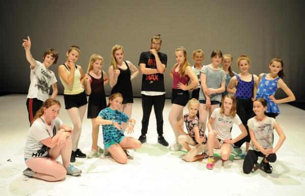 South Wales Argus: Ballet Cymru are in rehearsals for a Summer of dance at The Riverfront.  Pictured centre is dance choreographer Jamie Wall with his 13+ age group dance performers. (8432836)