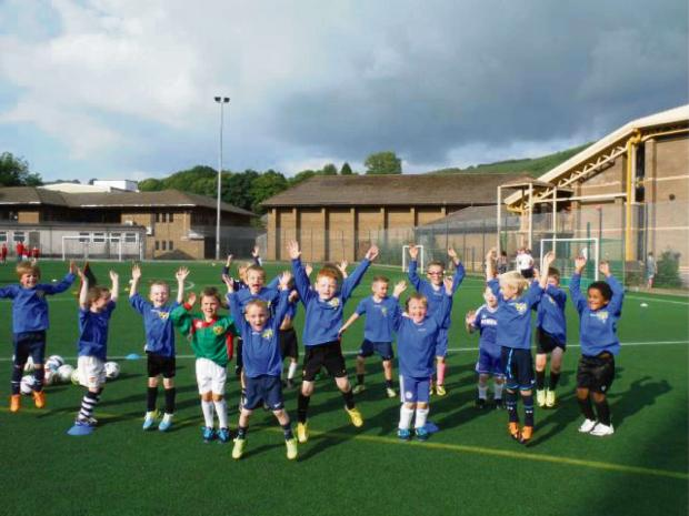 FUNDING BOOST: The Treowen Stars mini football under-7 and under-8 teams
