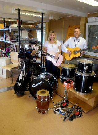 DRUMMING UP A RESALE  Re-use items which have been collected or slung out can now be purchased at the shop on the Wastesavers site in Docks Way, Newport. Pictured are Fiona Powell, senior contracts officer and Carl Touhig, recycling manager (8297287)