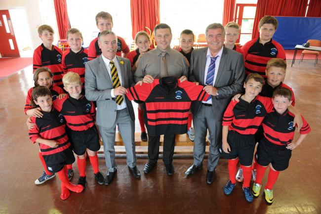 Millbrook Primary School rugby team received new kit from the international engineering company Laing O'Rourke.  Pictured with the new team colours from centre left Cllr Kevin Whitehead, Dan Johnson and Paul Ramshaw. (8250901)