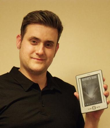 Author Craig Evans with his first book Harm's Way