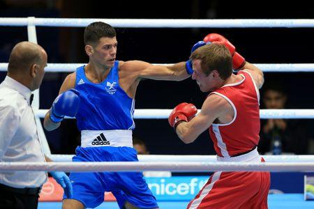 VICTORY: Wales' Joseph Cordina, in blue, on his way to beating Canada's David Gauthier
