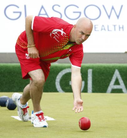 BRONZE: Wales' Marc Wyatt competes in the men's triples at Kelvingrove Lawn Bowls Centre