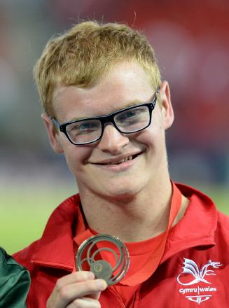 SPRINT STAR: Wales' Rhys Jones with his bronze medal after the men's para-sport T37 100m final