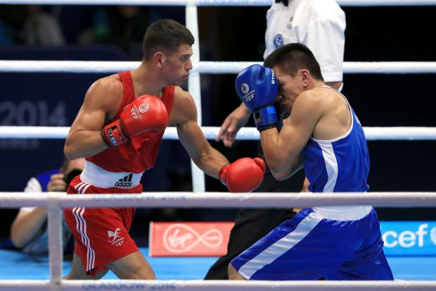 VICTORY: St Joseph's boxer Joe Cordina, left, on his way to a comfortable win over New Zealand's Chad Milnes in Glasgow