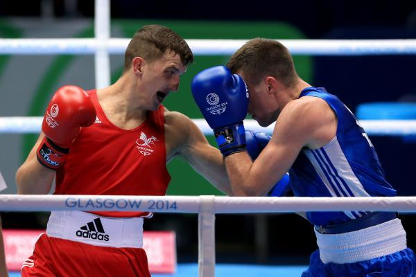 BRAVE DEFEAT: Wales' Zack Davies, left, was no match for Scotland's Josh Taylor