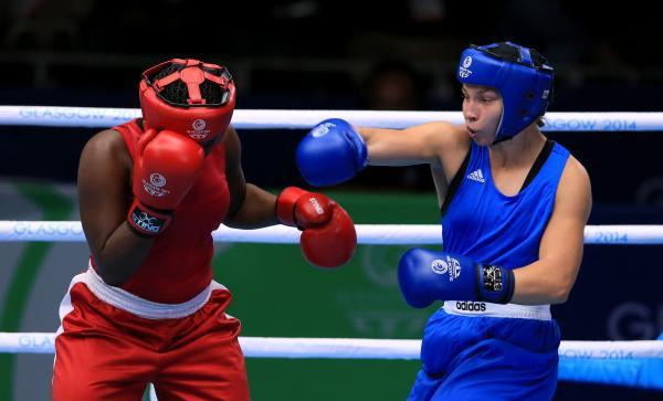 WINNER: Bargoed boxer Lauren Price, right, on her way to victory over Theresa London