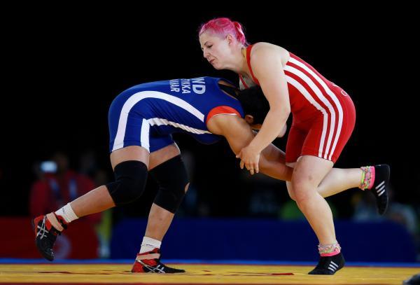 NO MEDAL: Welsh wrestler Sarah Connolly, right, was beaten by Cameroon's Blessing Oborududu