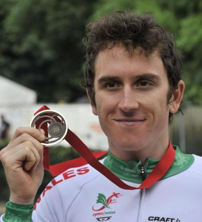 FLAG BEARER: Geraint Thomas today added road race gold to the time trial bronze he won on Thursday