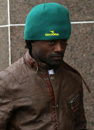 GUILTY: A shame-faced Francois Etoundi outside court in Glasgow yesterday