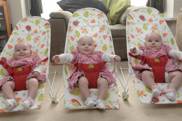 Similar triplets commemorate first birthday celebration