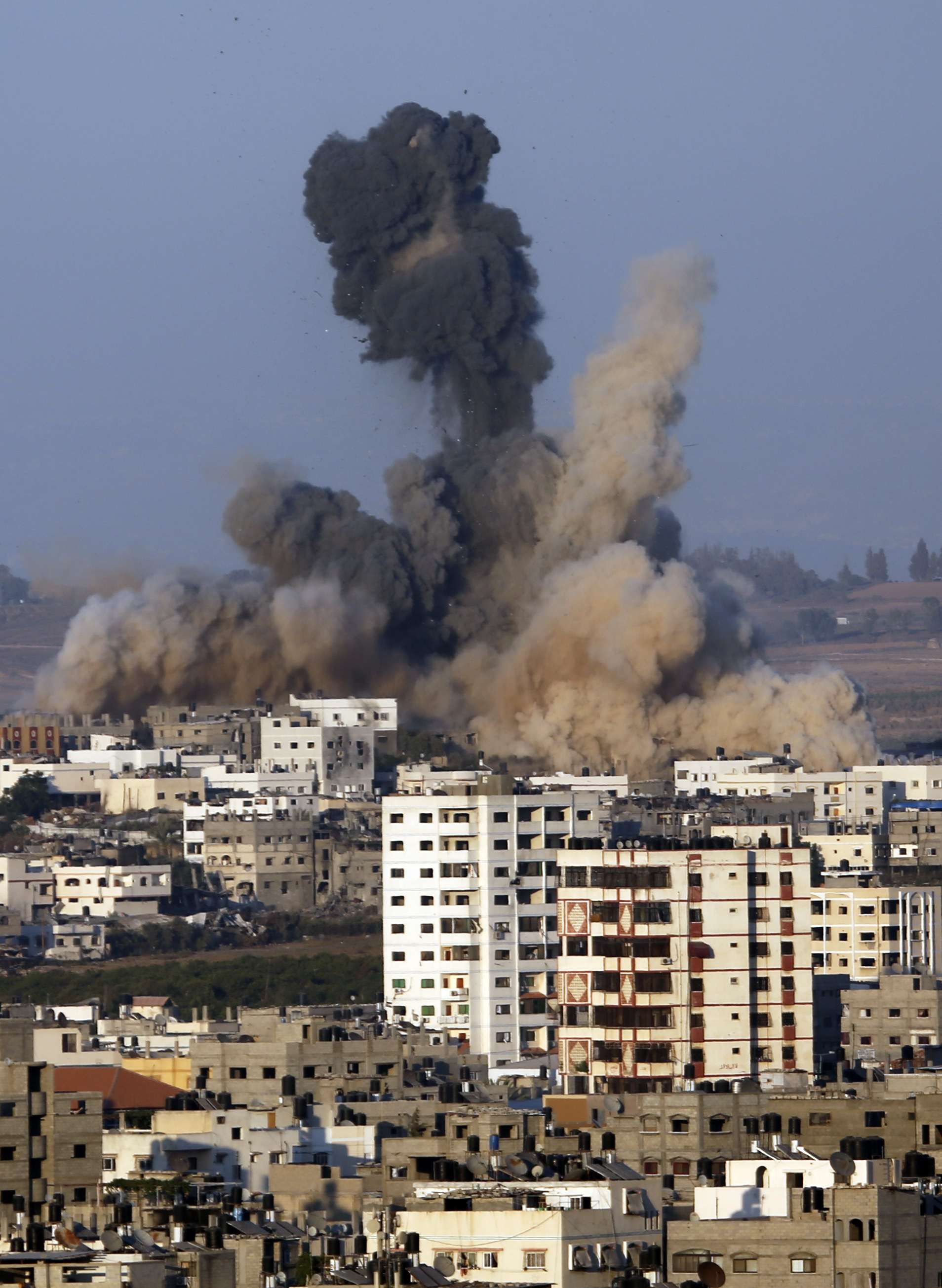 Smoke and sand rise in the air after an Israeli strike, in Gaza City, northern Gaza Strip, Saturday, Aug. 2, 2014. (AP Photo/Hatem Moussa)             (8871032)