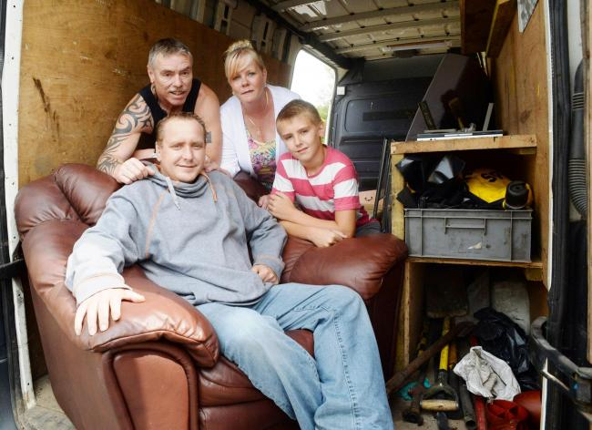 RESIDENTS' RESPONSE: Merv Whittington receives delivery of some furniture. He is pictured with (behind from left) Councillor Kevin Whitehead, Janet Freebury and Kevin's son Derry